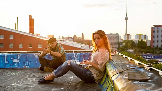 Two students learning above the roofs of Berlin.
